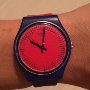 Purple and red swatch watch